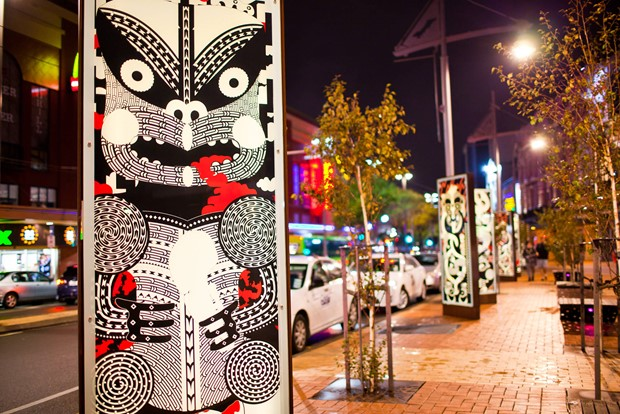 Modern black, white and red Māori face design on lightboxes in Courtenay Place, Wellington