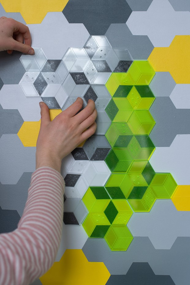 Isometric pattern in grey, yellow and neon green